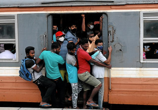 Passengers wearing protective masks travel on an over crowded train towards capital city, amid concerns about the spread of the coronavirus disease (COVID-19), in Colombo, Sri Lanka, July 8, 2020. (Photo by Dinuka Liyanawatte/Reuters)