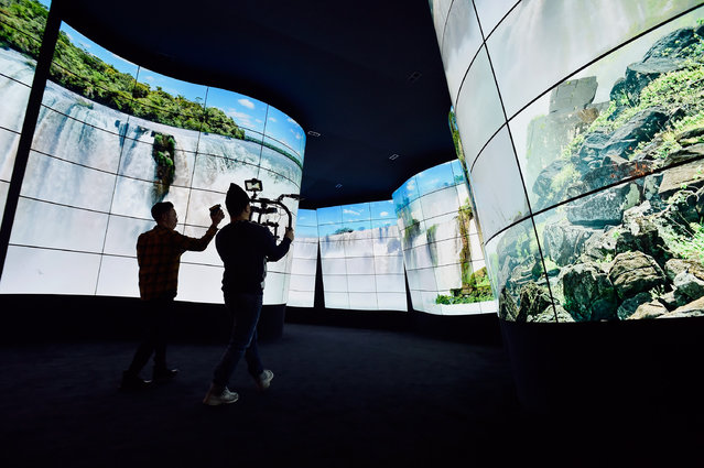 A video crew films the LG televison display at the LG booth during CES 2018 at the Las Vegas Convention Center on January 9, 2018 in Las Vegas, Nevada. (Photo by David Becker/Getty Images)