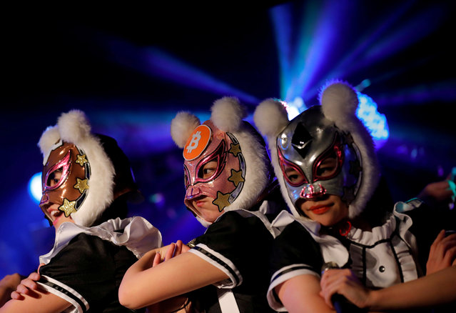 "Members of Japan's idol group ""Virtual Currency Girls"" wearing cryptocurrency-themed masks perform in their debut stage in Tokyo, Japan, January 12, 2018. Japanese female idols have teamed up to form the 'Virtual Currency Girls' group to promote the knowledge of cryptocurrencies through entertainment. Each of its 8 members represents a cryptocurrency: bitcoin cash, bitcoin, ether, neo, nem, ripple, mona, and cardano. (Photo by Kim Kyung-Hoon/Reuters)"