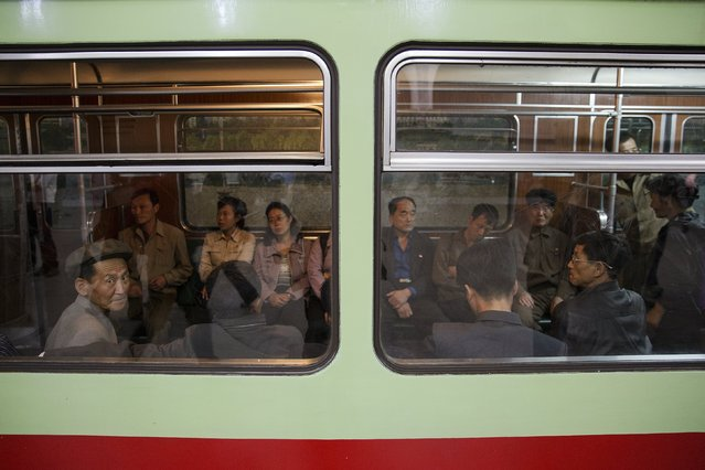 A man looks from inside a train that stopped at a subway station visited by foreign reporters during a government organised tour in Pyongyang, North Korea October 9, 2015. (Photo by Damir Sagolj/Reuters)