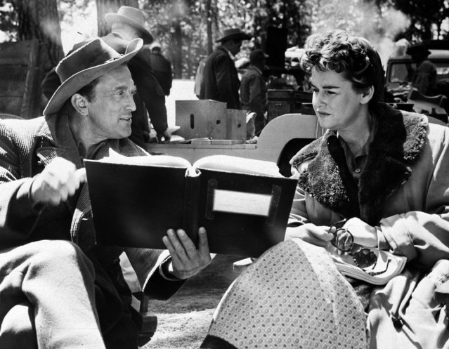 """In this June 8, 1955 file photo, actor Kirk Douglas and his former wife, Diana Douglas, go over their lines for a scene in """"The Indian Fighter"""", being made on location near Bend, Ore. Diana Douglas, the first wife of Kirk Douglas and mother of Michael Douglas, has died in Los Angeles. She was 92. Michael Douglas's production company says she died of cancer on Saturday at a movie industry retirement home in Woodland Hills. (Photo by AP Photo)"""