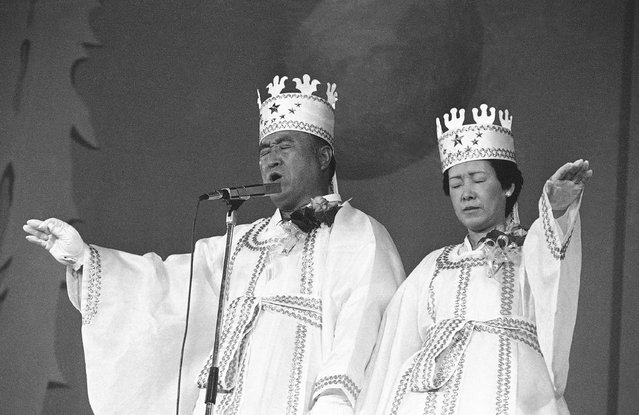In this October 14, 1982 file photo, Rev. Sun Myung Moon, left, and his wife Hak Ja Han, are shown during the traditional invocation of a blessing at a mass wedding in Seoul's Chamsil gymnasium where 6,000 couples from about 80 countries were married. Moon, self-proclaimed messiah who founded Unification Church, died at age 92 Monday, September 3, 2012, church officials said. (Photo by AP Photo)