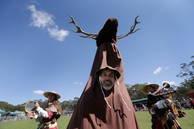 A performer dressed as a deer dances with a minstrel troupe at the St Ives Medieval Fair in Sydney, one of the largest of its kind in Australia, September 24, 2016. Medieval enthusiasts are swapping their day jobs for the knight life in a Sydney fair that's set to attract thousands. The St Ives Medieval Faire boasts archery demonstrations, bird of prey shows, viking battles and a world-class line up of jousters taking tilts at each other. (Photo by Jason Reed/Reuters)