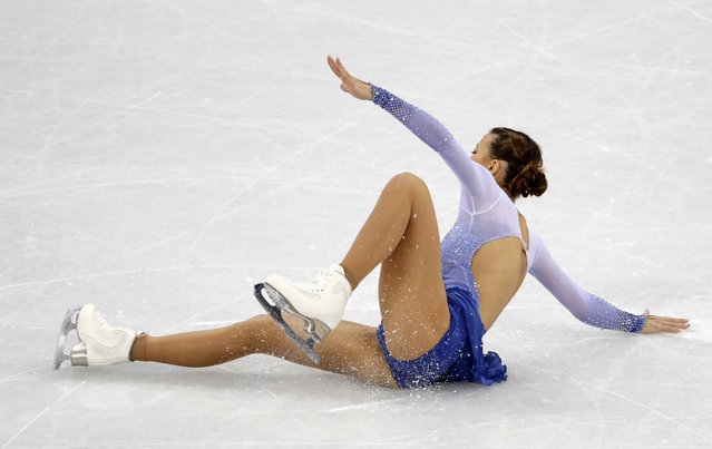 Germany' s Nicole Schott falls as she competes in the figure skating team event women' s single skating short program during the Pyeongchang 2018 Winter Olympic Games at the Gangneung Ice Arena in Gangneung on February 11, 2018. (Photo by Damir Sagolj/Reuters)