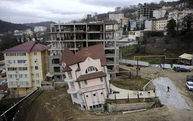 A leaning house in the Russian Black Sea resort of Sochi, Russia, on March 4, 2013. Reason: collapse of the automobile tunnel which built nearby for Winter Olympic Games 2014. (Photo by Mikhail Mordasov/AFP Photo)