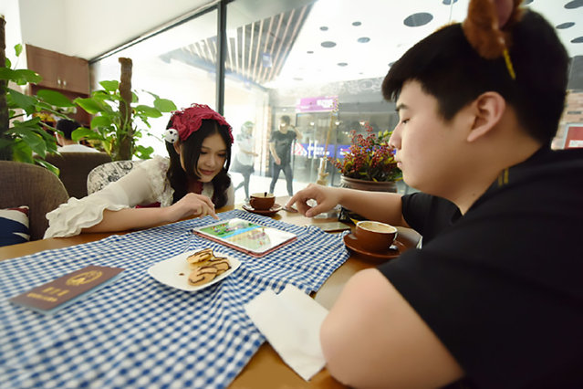 "The maid-themed cafe in Hangzhou, China on September 29, 2016. A cafe has been bringing in droves of new customers after hiring young women to dress up in Frech maid costumes while serving diners. Curious coffee- and coffee-lovers are coming from all corners of Hangzhou, capital of East China's Zhejiang Province, to get a taste of the ""maid cafe"" experience. The business is said to have been opened by a man surnamed Yu and his friends, all whom are natives or graduates of the city. Photo by AsiaWire)"