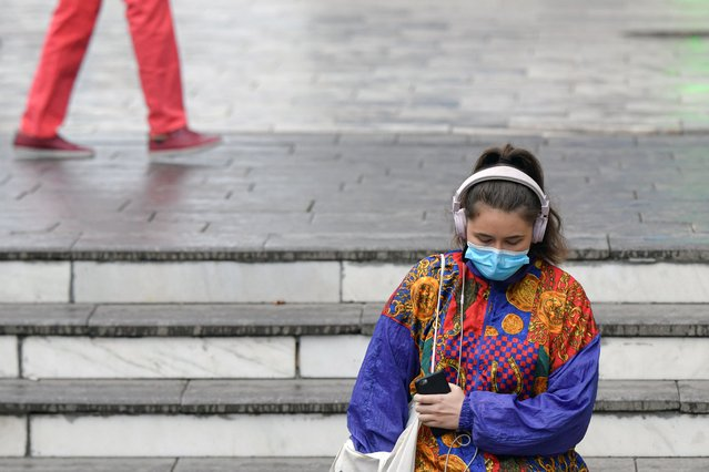 A woman wears a mask for protection against COVID-19 while going into a subway station in Bucharest, Romania, Thursday, October 8, 2020. The Czech government announced further restrictions in efforts to contain the coronavirus pandemic in the hardest hit country in Central and Eastern Europe. Thursday's announcement comes amid a record surge of infections that has been also recorded in most other countries across the region. Among others, all theaters, cinemas and zoo parks will be closed for at least two weeks. All sports indoor activities will be banned. (Photo by Andreea Alexandru/AP Photo)