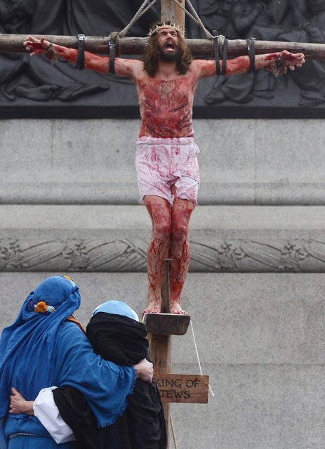 The Wintershall Players perform the Passion of Jesus in Trafalgar Square, London, on March 29, 2013. (Photo by Stefan Rousseau/PA Wire)