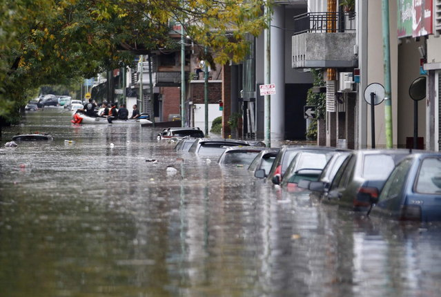 Submerged cars are seen in a flooded street after a rainstorm in Buenos Aires April 2, 2013. Thunderstorms damaged property and vehicles, cut power and caused delays on flights in Buenos Aires and its suburbs. The City's SAME emergency service announced that the death toll has risen to five. (Photo by Enrique Marcarian/Reuters)