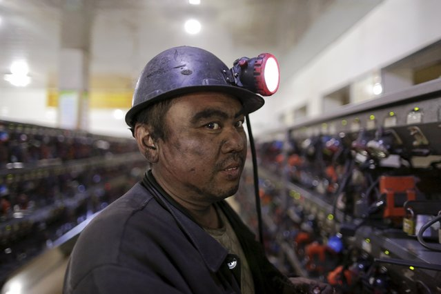 A miner is pictured before he takes his self-rescue equipment off after a day's work at a coal mine of the state-owned Longmay Group on the outskirts of Jixi, in Heilongjiang province, China, October 24, 2015. (Photo by Jason Lee/Reuters)