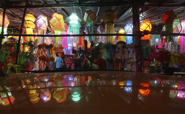 People shop for lanterns at a roadside stall ahead of Diwali, the Hindu festival of lights, in Mumbai, India, Saturday, November 7, 2020. Diwali will be celebrated on Nov. 14. (Photo by Rafiq Maqbool/AP Photo)