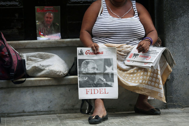 A woman sells Cuban Communist Party (PCC) official newspaper Granma with a picture of former Cuba's President Fidel Castro at the front page, at the main touristic road in Havana, Cuba, September 14, 2016. (Photo by Alexandre Meneghini/Reuters)