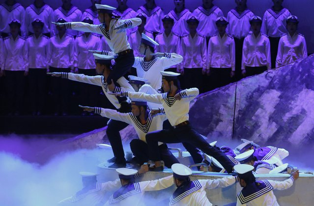 People perform during celebrations to commemorate the 70th anniversary of the establishment of the Vietnam People's Army at the National Convention Center in Hanoi December 20, 2014. (Photo by Reuters/Kham)