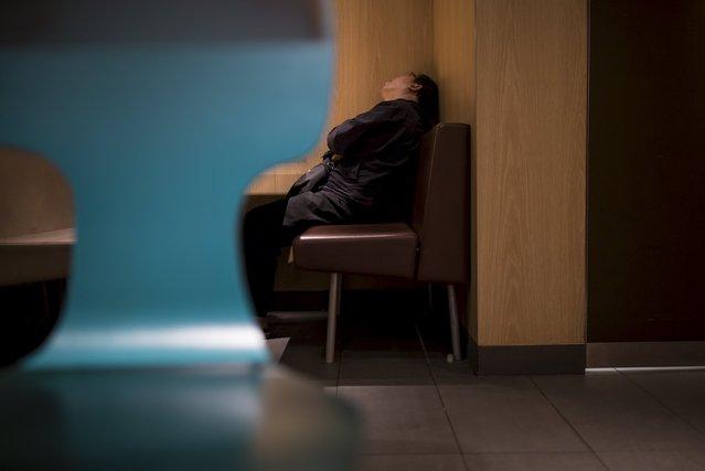 A man sleeps at a 24-hour McDonald's restaurant in Hong Kong, China November 10, 2015. (Photo by Tyrone Siu/Reuters)