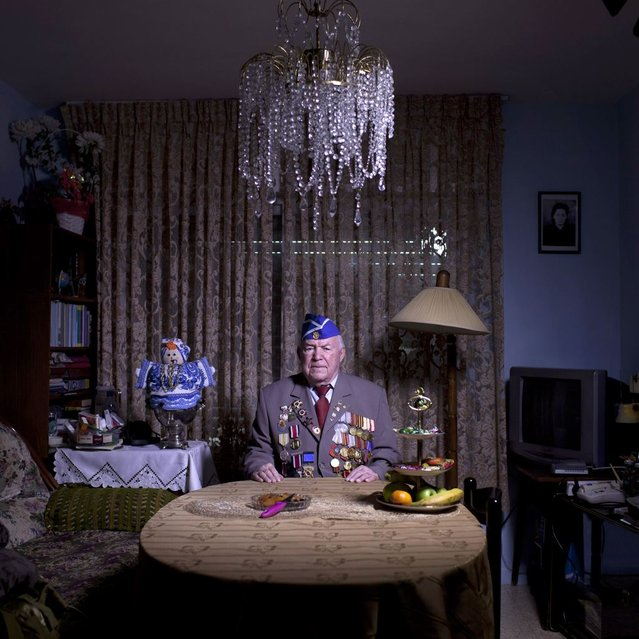 In this photo made Wednesday, April 17, 2013, Soviet Jewish World War Two veteran Michael Sandler, 93, poses for a portrait at his house in Jerusalem, Israel. Sandler joined the Red Army, in 1939, serve the 3rd Guards Tank Army, 91st Separate Tank Brigade; in Stalingrad, then in Berlin and Prague until the end of the war. Sandler immigrated to Israel in 1991. About 500,000 Soviet Jews served in the Red Army during World War Two, and the majority of those still alive today live in Israel. (Photo by Oded Balilty/AP Photo)