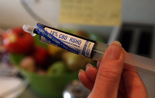 In this April 29, 2014 file photo, an oral administration syringe loaded with high CBD hemp oil for treating a severely-ill child is shown at a private home in Colorado Springs, Colo. (Photo by Brennan Linsley/AP Photo)