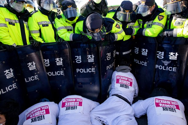 Non-regular workers in protest are clashing with police near the Yeouido National Assembly urge the enactment of the serious disaster enterprise punishment law on December 14, 2020 in Seoul, South Korea. (Photo by Sanghwan Jung/Rex Features/Shutterstock)