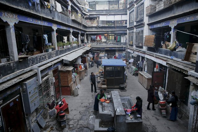Tibetan women wash clothes at the courtyard in the old part of Lhasa, Tibet Autonomous Region, China November 16, 2015. (Photo by Damir Sagolj/Reuters)