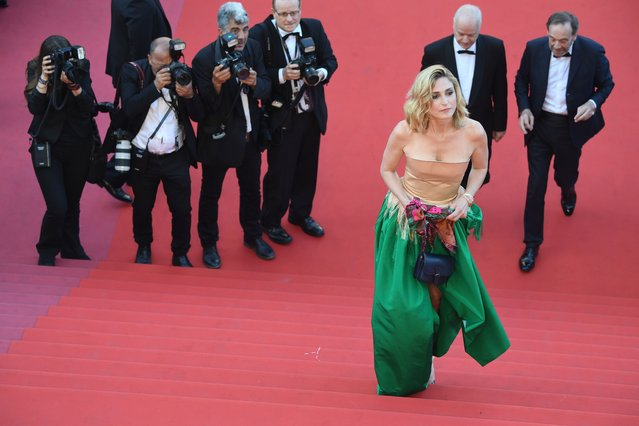 """French actress and producer Julie Gayet walks the steps as she arrives on May 11, 2018 for the screening of the film """"Ash is Purest White ( Jiang hu er nv)"""" at the 71 st edition of the Cannes Film Festival in Cannes, southern France. (Photo by Antonin Thuillier/AFP Photo)"""