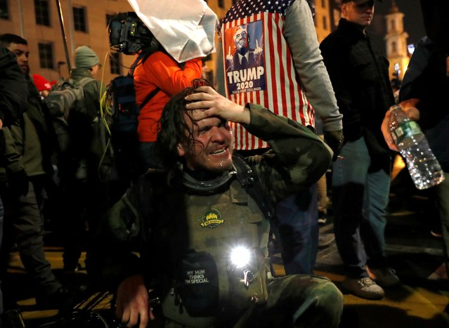 A supporter of U.S. President Donald Trump reacts after being pepper sprayed by police during a protest, in Washington, U.S., ahead of the U.S. Congress certification of the November 2020 election results, January 5, 2021. (Photo by Shannon Stapleton/Reuters)