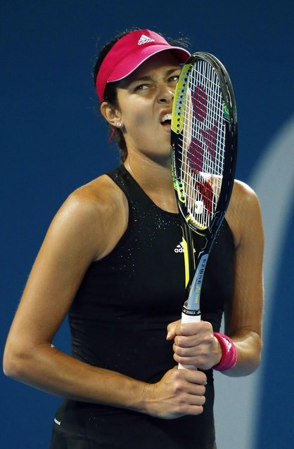 Ana Ivanovic of Serbia bites her racquet after losing a point during her women's singles final match against Maria Sharapova of Russia at the Brisbane International tennis tournament in Brisbane, January 10, 2015. (Photo by Jason Reed/Reuters)