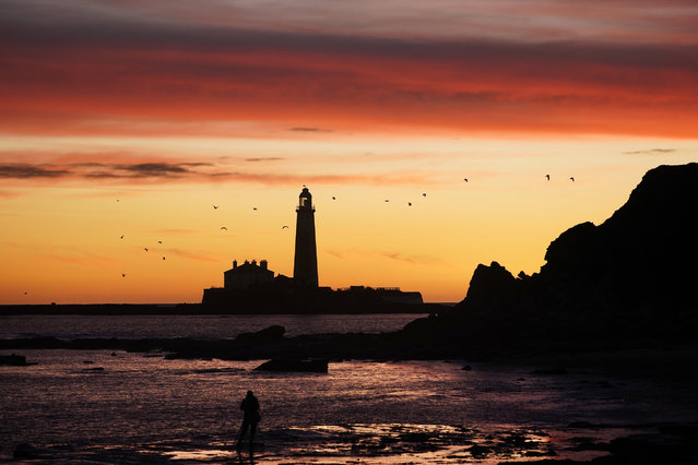 A pallet of changing colours as the sky lights up before sunrise at St Mary's Lighthouse in Whitley Bay, Tyne and Wear on the North East coast on November 22, 2020. (Photo by Owen Humphreys/PA Images via Getty Images)