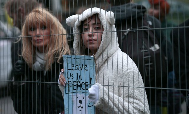 A protester wears a polar bear outfit during a rally held the day before the start of the Paris Climate Change Summit, in London, Britain November 29, 2015. (Photo by Suzanne Plunkett/Reuters)