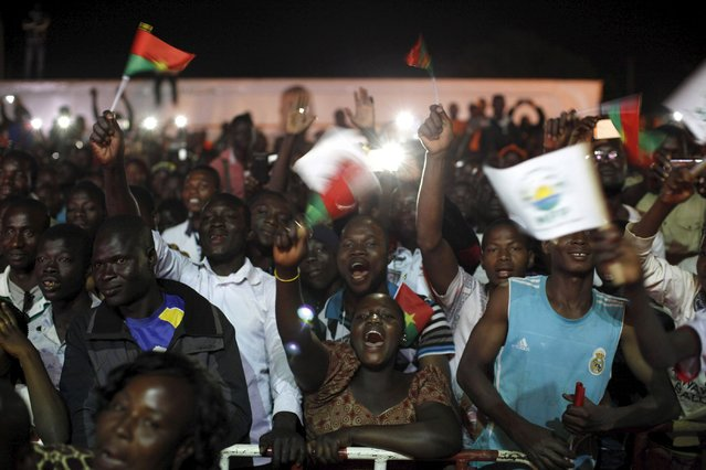 Supporters of President-elect Roch Marc Kabore cheer at Kabore's campaign headquarters in Ouagadougou, December 1, 2015. Roch Marc Kabore was proclaimed the winner of the presidential election in Burkina Faso and will become the country's first new leader in decades, the Independent National Electoral Commission said on Tuesday. (Photo by Joe Penney/Reuters)
