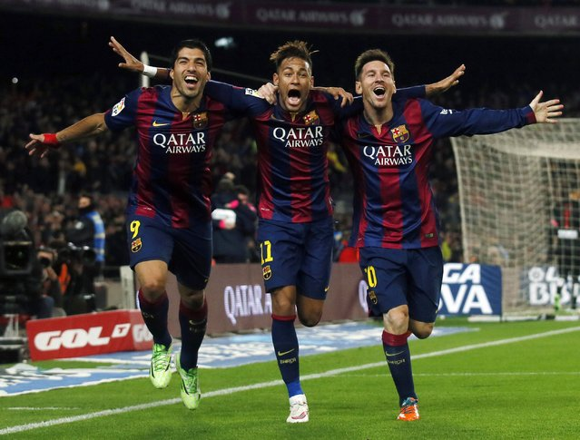 (L-R) Barcelona's Luis Suarez, Neymar and Lionel Messi celebrate a goal against Atletico Madrid during their Spanish First Division soccer match at Camp Nou stadium in Barcelona January 11, 2015. (Photo by Albert Gea/Reuters)