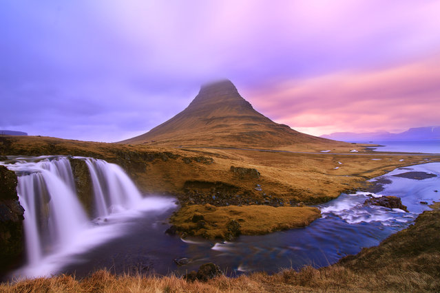 """Dreamy Waterfalls"". Kirkjufellsfoss Waterfalls is located in West Iceland. An amazing place to be for a Landscape Photographer. The Kirkjufell Mountain has created an ideal backdrop for the falls and the sun creates amazing color in that Arctic region during sunset. (Photo and caption by Neloy Bandyopadhyay/National Geographic Traveler Photo Contest)"