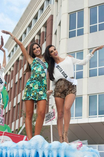 Miss Colombia 2014 Paulina Vega and Miss Costa Rica 2014 Karina Ramos take part in a cultural parade and festival in Miami in this January 11, 2015 picture provided by the Miss Universe Organization. (Photo by Reuters/Miss Universe Organization)