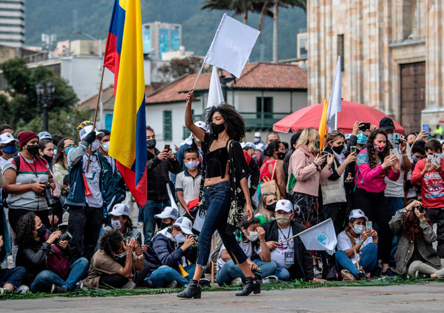 A model presents a creation by former FARC combatants during a demonstration demanding peace accords to be respected, at Bolivar square in Bogota on November 03, 2020. (Photo by Juan Barreto/AFP Photo)