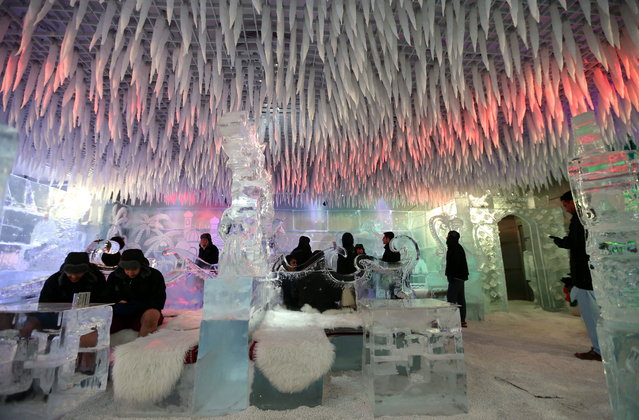 "People visit the ""Chillout the Ice Lounge"" in Dubai, United Arab Emirates, 08 July 2018. Residents and tourists visit the minus-six degrees Celsius Chillout the Ice Lounge or Cafe in the desert Gulf emirate of Dubai to cool off themselves while the temperatures over 47 degrees Celsius that was recorded in the country recently. (Photo by Ali Haider/EPA/EFE)"