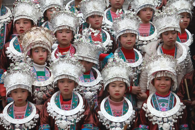 Ethnic Dong children wearing traditional costumes attend Duoye Festival, in Sanjiang, Guangxi Zhuang Autonomous Region, December 26, 2015. Locals hold chorus and group dancing activities during the festival, according to local media. (Photo by Reuters/China Daily)