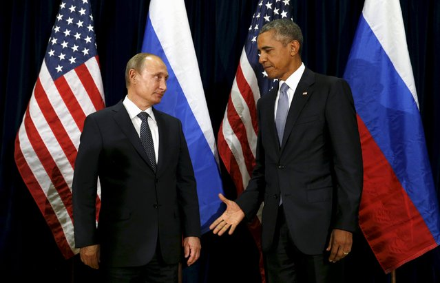 U.S. President Barack Obama extends his hand to Russian President Vladimir Putin during their meeting at the United Nations General Assembly in New York September 28, 2015. (Photo by Kevin Lamarque/Reuters)