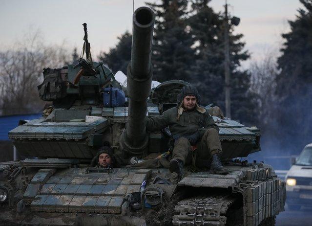 Ukrainian servicemen ride on a tank near Artemivsk, eastern Ukraine, February 8, 2015. (Photo by Gleb Garanich/Reuters)