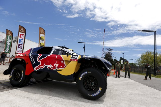 Peugeot driver Stephane Peterhansel of France drives his car as he leaves the technical verification area ahead of the Dakar Rally 2016 in Buenos Aires, Argentina, January 1, 2016. (Photo by Marcos Brindicci/Reuters)