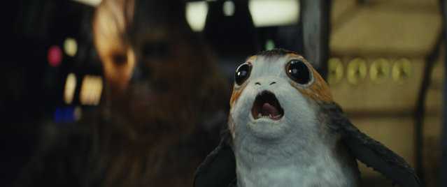 "This image released by Lucasfilm shows Chewbacca, left, and a Porg in a scene from ""Star Wars: The Last Jedi"". (Photo by Lucasfilm via AP Photo)"