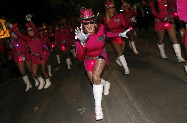 A member of the Camel Toe Lady Steppers dances down St. Charles Avenue during a Mardi Gras parade in New Orleans, Louisiana February 12, 2015. (Photo by Jonathan Bachman/Reuters)