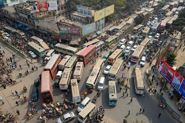 An aerial view of a busy street during a countrywide dawn to dusk strike called by the Jamaat e-Islami, in Dhaka, Bangladesh, 07 January 2016. Jamaat enforced the shutdown in protest against the death penalty of their chief leader Motiur Rahman Nizami who is convicted for his crimes during the liberation war against Pakistan in 1971. (Photo by Abir Abdullah/EPA)