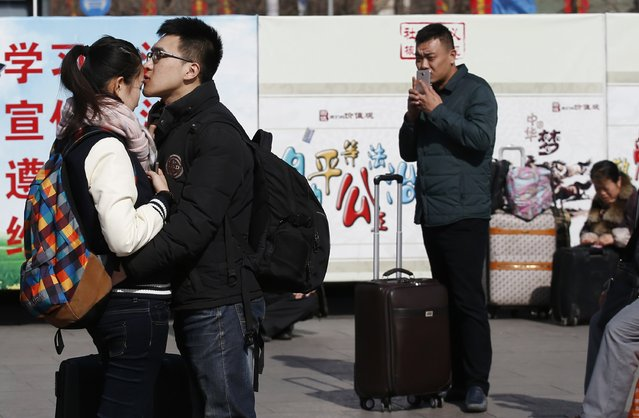 A couple kisses at a railway station in Beijing February 16, 2015. (Photo by Kim Kyung-Hoon/Reuters)