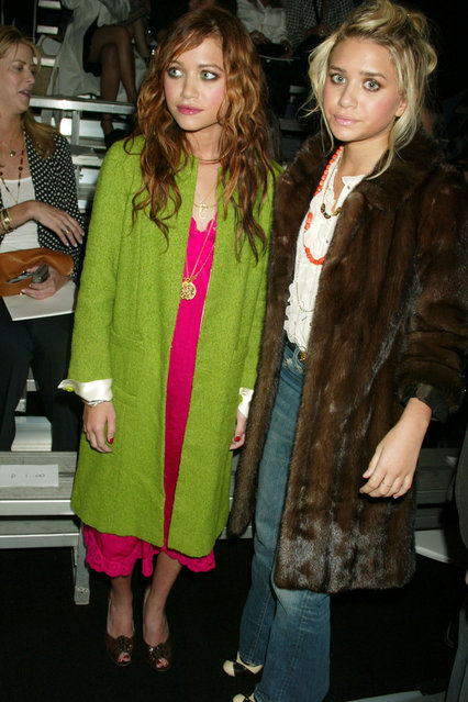 Mary Kate Olsen and Ashley Olsen during Olympus Fashion Week Spring 2005 – Marc Jacobs – Front Row at Pier 54 in New York City, New York, United States. (Photo by Gregory Pace/FilmMagic)