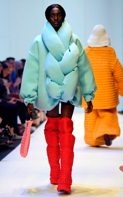 A model parades an outfit by RMIT fashion student Tara Sutherland during a Melbourne Fashion Week show on September 5, 2018. (Photo by William West/AFP Photo)