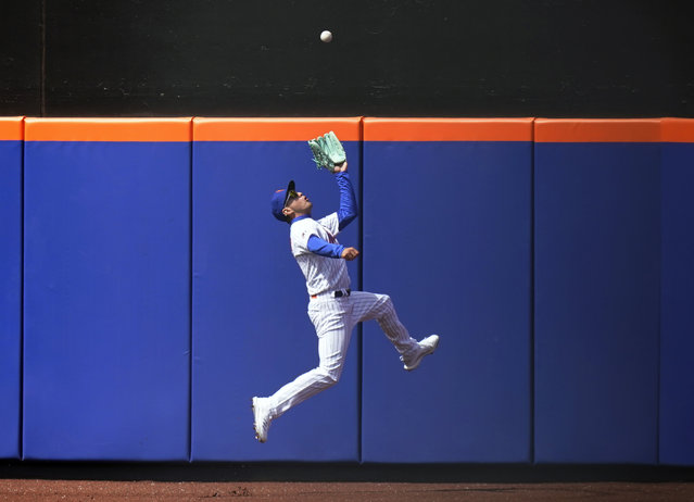 New York Mets center fielder Albert Almora Jr. makes a leaping catch during the sixth inning of a baseball game against the Washington Nationals at Citi Field, Sunday, April 25, 2021, in New York. (Photo by Seth Wenig/AP Photo)