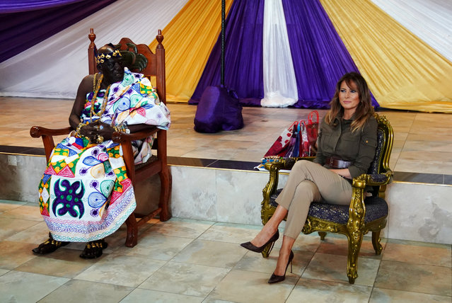 US First Lady Melania Trump sits alongside Osabarimba Kwesi Atta II, the chieftan of the regional Fante tribe (L), at the Emintsimadze palace in Cape Coast, Ghana, October 3, 2018. US First Lady Melania Trump is on a solo tour of Africa to promote her children' s welfare programme. (Photo by Carlo Allegri/Reuters)
