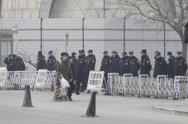 Police guard outside the Malaysian embassy on the one-year anniversary of the disappearance of Malaysia Airlines Flight MH370, in Beijing March 8, 2015. China's foreign minister said on Sunday the search for the Malaysian Airlines flight which vanished one year ago will not stop, adding that the government will keep providing whatever help it can to relatives of those on board. No trace has been found of the Malaysia Airlines Boeing 777 aircraft, which disappeared a year ago on Sunday carrying 239 passengers and crew, in what has become one of the greatest mysteries in aviation history.    REUTERS/Jason Lee (CHINA - Tags: DISASTER TRANSPORT ANNIVERSARY POLITICS)