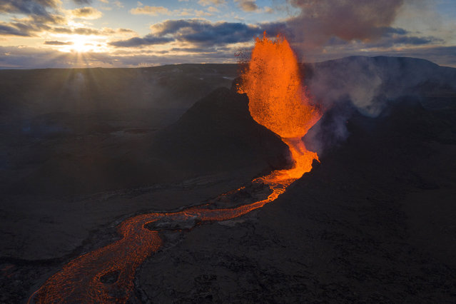 Lava flows from an eruption of the Fagradalsfjall volcano on the Reykjanes Peninsula in southwestern Iceland on Tuesday, May 11, 2021. (Photo by Miguel Morenatti/AP Photo)
