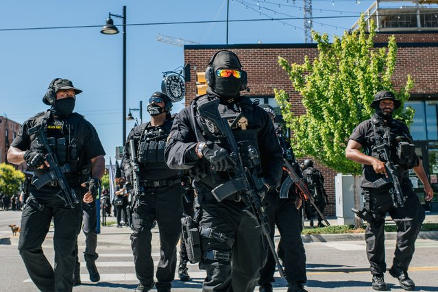 Members of the Black Panther Party and other armed demonstrators rally in the Greenwood district during commemorations of the 100th anniversary of the Tulsa Race Massacre on May 29, 2021 in Tulsa, Oklahoma. (Photo by Brandon Bell/Getty Images)