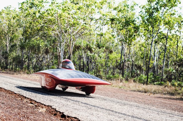 A handout image of the Red Engine Team obtained on 04 October 2013 shows the Red Engine going for a test drive on Cox Penninsula Road outside Darwin, Australia, 21 September 2013. The Dutch vehicle is competing in the World Solar Challenge, driving from Darwin to Adelaide starting on 06 October 2013. (Photo by Joost Van Baars/EPA/Red Engine Team)