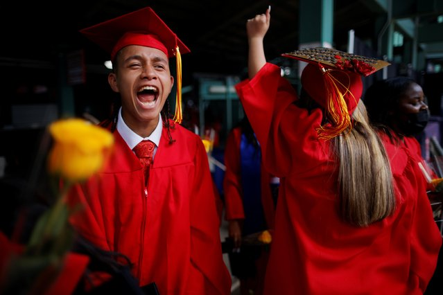 High school seniors celebrate after receiving their diplomas as the Josiah Quincy Upper School held its graduation ceremonies at Fenway Park, home of Major League Baseball's Boston Red Sox, for greater safety during the coronavirus pandemic, in Boston, Massachusetts, June 8, 2021. (Photo by Brian Snyder/Reuters)
